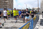 RUNNERS ENTER JAFFA GATE, IN THE OLD CITY, DURING THE ANNUAL JERUSALEM MARATHON   © DA-B
