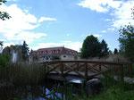 """""""Normalbelichtung"""" - die Kamera misst. Jedoch ist das schöne Wolkenbild eher ausgewaschen, die Brücke wieder eher dunkel"""