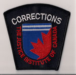 "Corrections - The Justice Institute of Canada  (Fond noir avec le ""S""  /  Black background with the ""S"")  (Holland College)  (Î-P-É / PEI)  (Actuel / Current)"