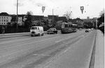 Verkehr auf der Wettsteinbrücke mit einem Tram der Linie 2, während der MUBA (Mustermesse Basel), 1970