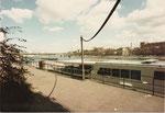 Das Passagierschiff «MS URSULA» mit Blick gegen die Johanniterbrücke und das Kleinbasel, im Hintergrund der St.Johann-Hafen, 1975