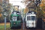 Zwei Trammotorwagen der Serie Be 4/4 bereit zum Verschrotten in der Abstellanlage Eglisee im Herbst, 2000
