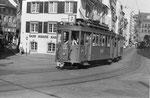 Tramzug mit Motorwagen Be 4/4 Nr.156 auf der Linie 7 in der Falknerstrasse den Barfüsserplatz anfahrend, 1970