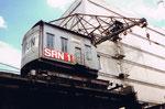 Der Kran Nr.1 der SRN (ehemals NEPTUN) im Rheinhafen Basel im Hafenbecken 1, 1976
