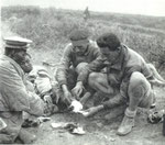 Teilhard and Dr. Delastre, the Citroen expedition's doctor treating the wounded.