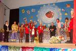 Die Ehrengäste auf der Bühne