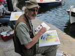 Tom beim Malen im Hafen von Agios Nikolaos