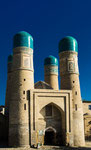 """Chor-Minor Madrassah is a 19th century charming and picturesque structure situated northeast from Lyab-i Hauz. The name means """"four minarets"""" in Tajik, but this interesting little site with four towers was actually a gatehouse of a medressah."""