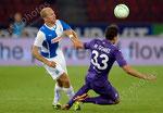 Stephane Grichting (L,GCZ) gegen Mario Gomez (Fiorentina)