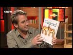 """Dennis stellt das Buch """"Wildesel"""" von Denzau vor."""