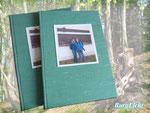 Bindung loser Blätter zum Buch mit festem Einband und Erstellung eines Duplikates.