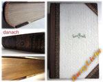 Buchpflege - Bild 2/2 danach - Buchrücken erneuert - Cover und Schnitte gereinigt - Schnittverzierung gefunden - ursprüngliche Form hergestellt