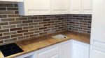 Кухонная столешница с подоконником из гранита Айвари Браун. Мойка интегрированная подстольного монтажа Blanco