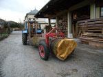 transport d'une grume avec le tracteur