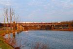 Mit etwas Verspätung überfährt ein TGV Duplex als TGV 9552 Frankfurt Main Hbf - Paris Est die Saar, Abend um 19:15 Uhr am 02.04.2013 in Saarbrücken
