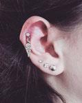 piercinh helix cartilage cicatrisé avec bijou plume realisé par Piou Abitbol chez Lucky30 à nîmes
