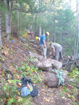 Stones are brought to the trail as the crew sets up to build a staircase
