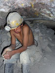 A young miner (13 years) chewing coca leaves