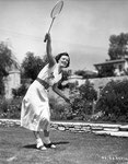 1934 - promo shot playing badminton on the court of her Hollywood home