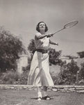 1934 - playing badminton on the court of her Hollywood home