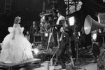 during filming, director Rouben Mamoulian on the right