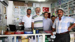 Mr. Cengil and team in his pharmacy, Kinic