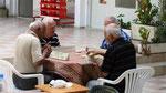 Retired men playing Okey