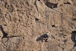 Kletterer übten an der glatten Felswand