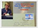 "On the postcard letter to Jenny, Emma puts the stamp ""Roter Sand"" (Red Sand), issued as part of the special postage stamp series ""Leuchttürme"" (lighthouses)."