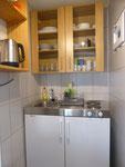 Kochnische Appartment 1 mit Garten vorne