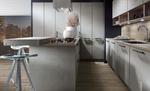 Façades effet béton - Mélange avec bois clair pour les niches ouvertes et le plan de travail - Poignées au style industriel.