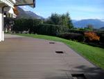 Terrasse bois composite, réservations intégrées pour bacs à plantes