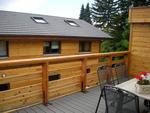Terrasse bois composite, garde-corps mélèze.