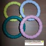 Beissringe (lemon, hellblau, rosa, dunkeltürkis)