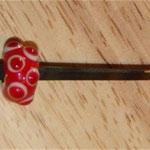 Perle auf Hufnagel