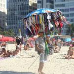 Comment vendre des maillots sur la plage, tout en se protégeant du soleil et en montrant le maximum d'articles !!