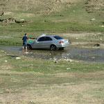 Auto waschen im Fluss