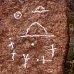 in evidenza alcune incisioni, secondo alcuni la descrizione di un contatto alieno preistorico