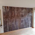 Fototapete einer Betonwand in einem Schlafzimmer.