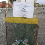 A labeled nest-protection-cage misused as garbage bin