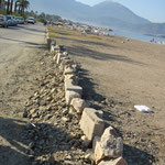Stony barriers help to prevent cars from entering the beach