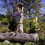 Brunnen mit Hl. Florian (im Garten)