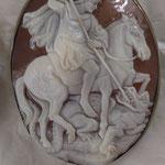 Spilla e ciondolo in argento con cammeo