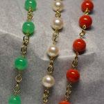 Bracciali in oro 18 kt con corallo perle e crisopazio