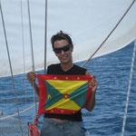 Izando el pabellón de Grenada