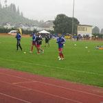 Training der Profis bei Regenwetter