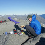 Chrissi enjoying breakfast on the Barrier Knob ridgeline, Darran Mountains.