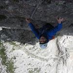 Chrissi climbing the 7b crux pitch.