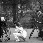 THE BICYCLE (1) - A hilarious scene which I've shot in two pictures in Amsterdam in 1987: A guy was fixing the bicycle of a lady, while another chap was watching...