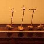 Equilibri, 2013, noci di cocco, legno, segatura e ferro, 35h x 75 x 25 cm